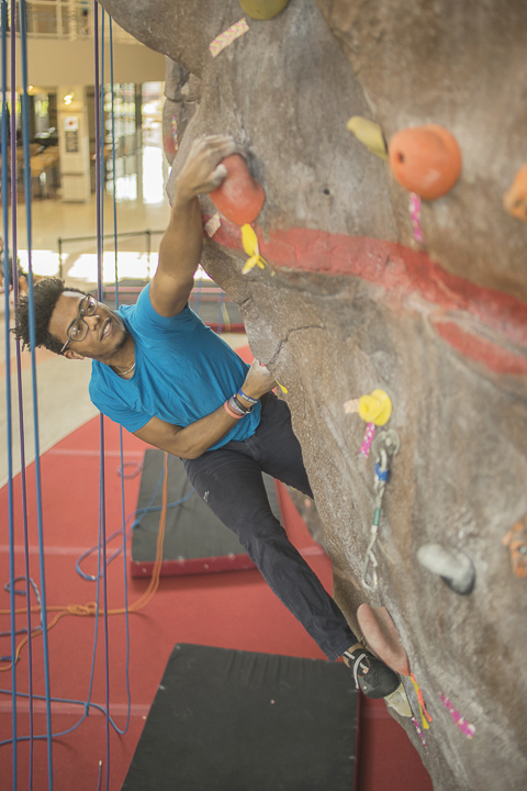 Leonard Ifield, a mechanical engineering student from Port Arthur, climbs up the rock wall in the Sheila Umphrey Recreational Sports Center, Tuesday. UP photo by Noah Dawlearn