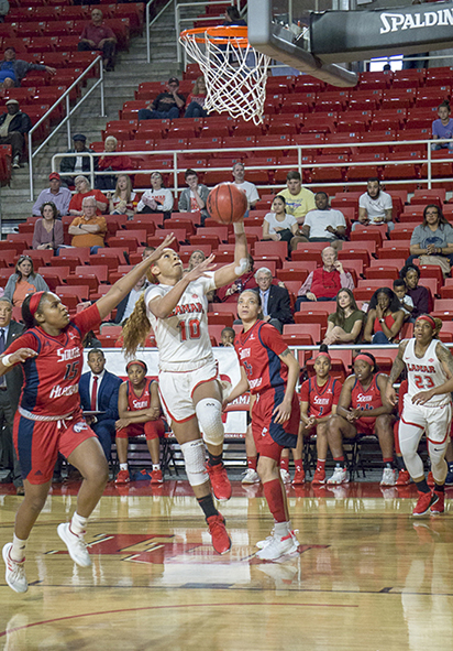 Chastadie Barrs, LU senior guard, goes for a layup against South Alabama defenders, in the first round of the WNIT, Friday in the Montagne Center. UP photo by Cade Smith