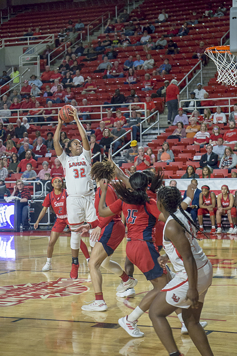Umaja Collins, LU freshman center, rebounds the ball against South Alabama defenders, in the first round of the WNIT, Friday in the Montagne Center. UP photo by Cade Smith