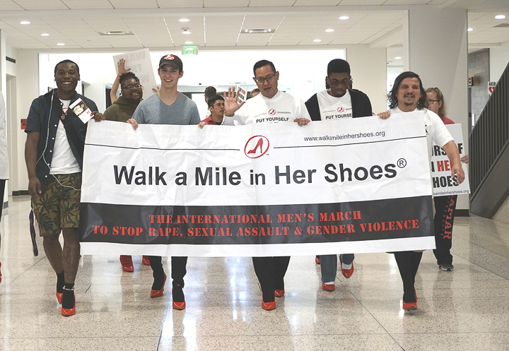 "Students and faculty march across campus for LU's annual ""Walk a Mile in Her Shoes,"" Tuesday. The march is part of the international men's march that brings awareness to sexual assault, rape and gender violence. UP photo by Abigail Pennington"