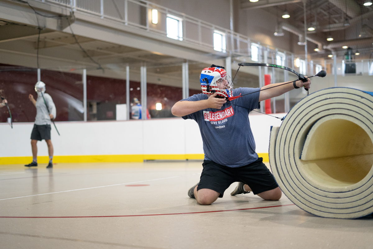 Stephen Rambin, Chemical Engineering Major from Mauiceville, aims his air in archery tag at the indoor soccer arena in the Sheila Umphrey Recreational Sports Center on Aug 28.