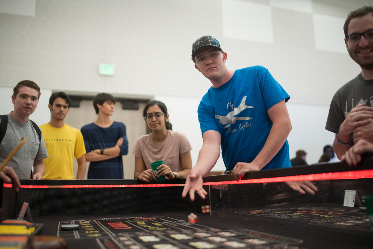 Lamar Student rolls the dice for a game of craps inside the ball room of the Setzer Student Center on Aug 28.