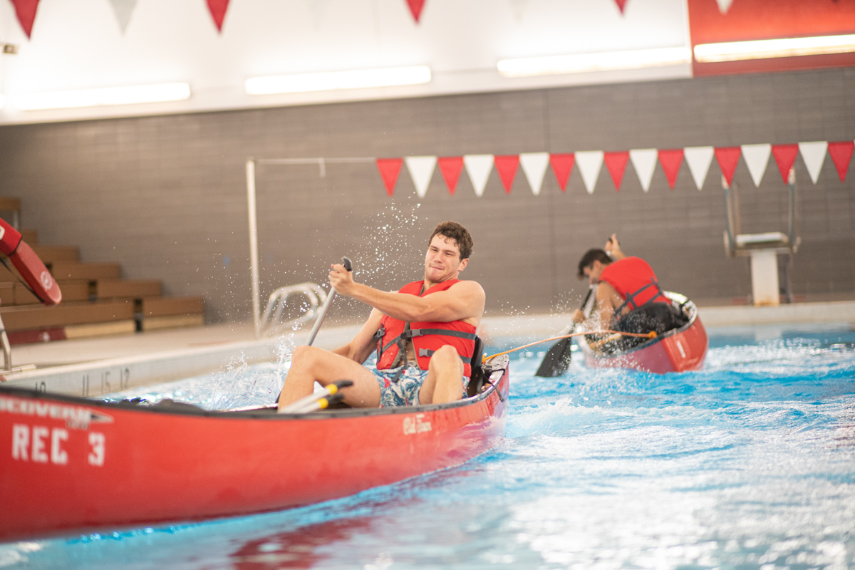 Lamar Students paddle canoes in a water based version of tug of war at the pool inside of the Health and Human Performance Building A on Aug 28.