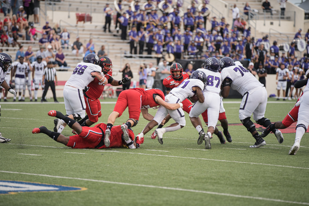 Lamar football players tackle SFA running back during the homecoming game at Provost Umphrey Stadium on Sep 28. UP photo by Noah Dawlearn