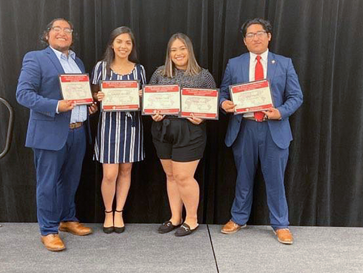 Cesar Delgado, junior, left, Jennifer Caltzontzi, senior, Melissa Torres, senior, and Julio Delgado, senior, were honored for their contributions to the Lamar Latinx community at the Annual Excellence Banquet, Oct. 4
