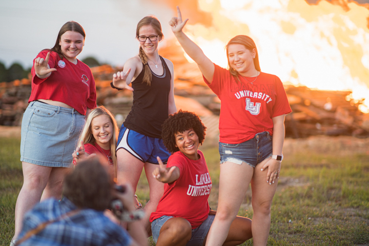 Students make the LU sign during Lamar University's Homecoming Pep Rally and Bonfire, Sept. 27. UP photo by Noah Dawlearn