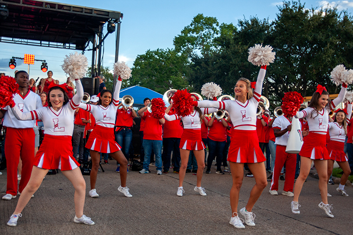 LU's spirit squad cheer during the Homecoming Pep Rally and Bonfire, Sept. 27. UP photo by Delicia Rocha