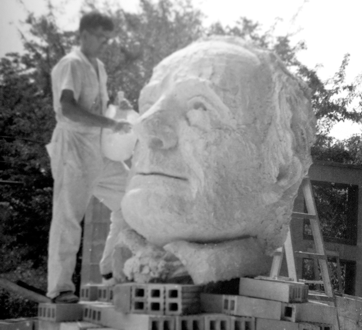 David Cargill works on the statue of Mirabeau B. Lamar, far left, which sits in the Quad at Lamar University.