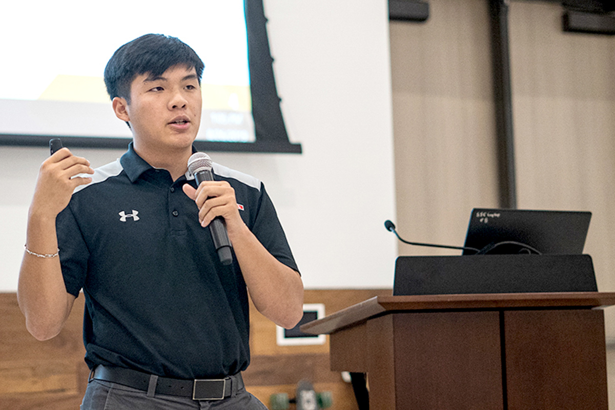 Student Government Association president Edward Doan, above, explains SGA's proposed initiatives for more campus inclusivity during an open table discussion  in the Live Oak Ballroom in September. UP photo by Noah Dawlearn