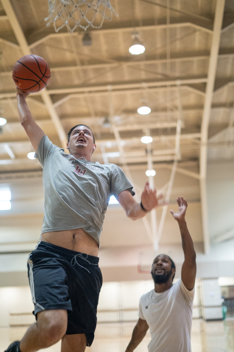 Philip Jacobs, left, goes for a layup against Zion Diggles, right, in the Sheila Umphrey Recreational Sports Center, Sept. 24. UP photo by Noah Dawlearn