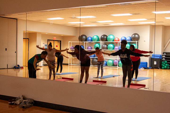 Edwin, the yoga instructor, teaches the class certain poses at Late Night at the Rec on Jan. 24 in the Sheila Umphrey Recreational Center. UP Photo by Delicia Rocha.