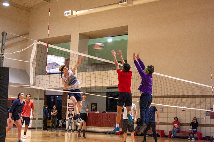 Students play a round of volleyball at Late Night at the Rec on Jan. 24 at the Sheila Umphrey Recreational Center. UP Photo by Delicia Rocha.