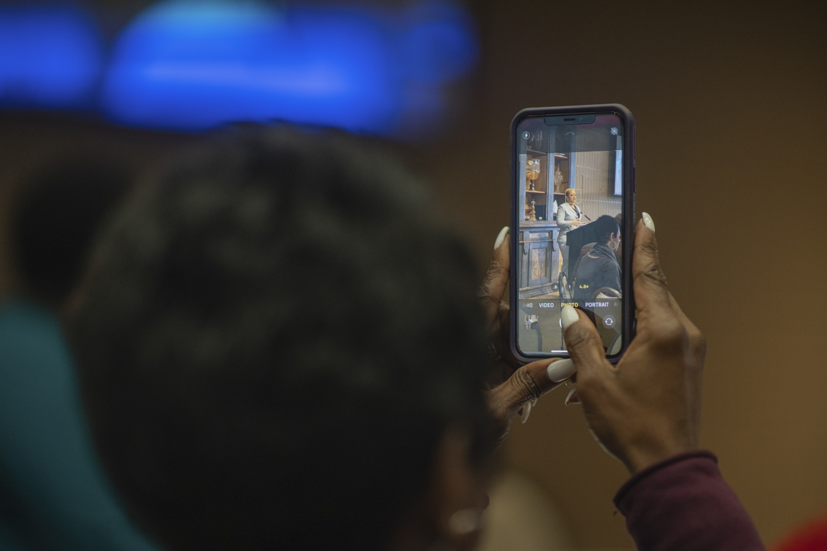 Zena Stephans, left, takes a picture of Japera N. Levine, right, the keynote speaker of the MLK day Event that was hosted in the 8th floor of the John and Mary Gray Library on Thursday. UP Photo by Noah Dawlearn