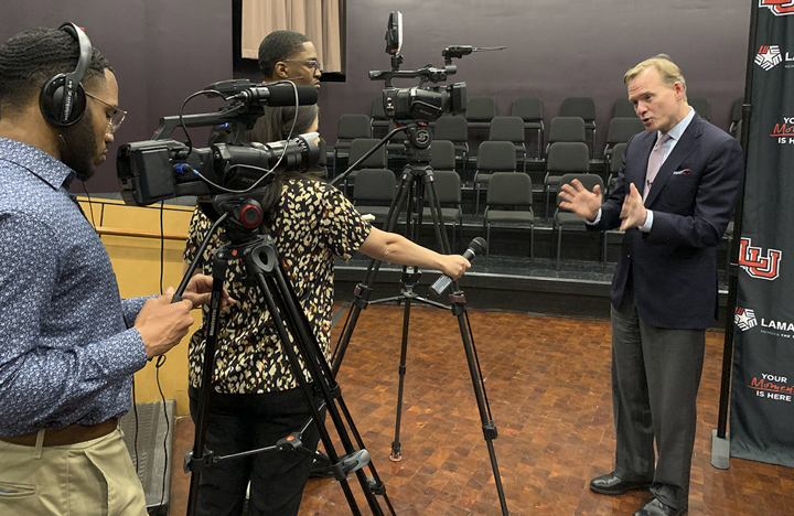John Dickerson gives an interview to Channel 6 and LUTV News, Monday, in the Rothwell Recital Hall. UP photo by Olivia Malick