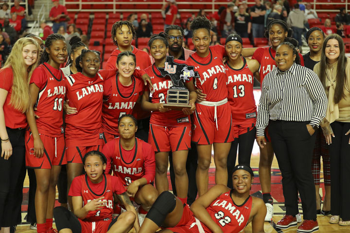 The Lady Cardinals celebrate after beating the McNeese State  Cowgirls 80-70  in the Southland Conference season finale. Courtesy photo