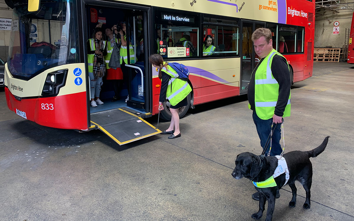 Daniel Walker and his guide dog Pebble joined LU students as they learned about the Brighton bus company's accessibility initiatives during a study abroad program in June 2019.